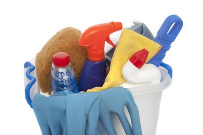 A bucket of domestic cleaning products